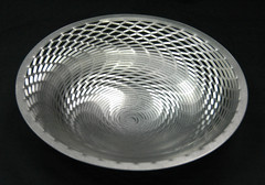 """Stainless steel, with a custom hand finish.10-1/2"""" diameter x 2-1/2"""" high$150.00"""